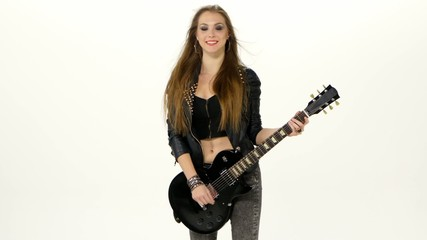 Beautiful young brunette girl with the electric guitar on a