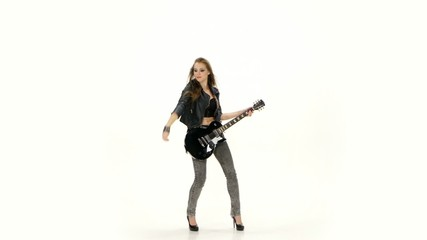 Beautiful young girl playing on electric guitar on a white