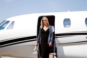 Lady Diva on steps of plane