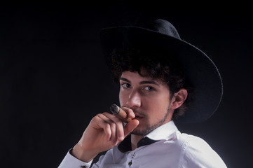 smoking cigar portrait with hat