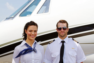 Pilot and stewardess ready for passengers