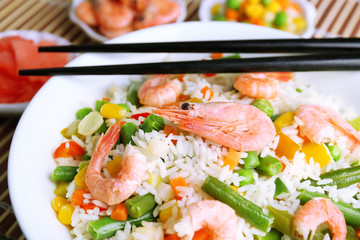 Boiled rice with shrimps and vegetables, close-up,