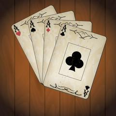 Aces poker cards old look varnished wood background