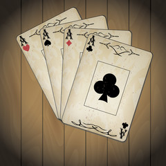 Aces, poker cards old look varnished wood background