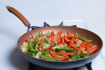 A Pan Full of Peppers and Onions