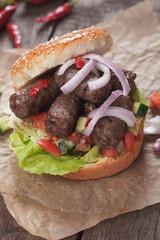 Kebab burger with vegetable salad