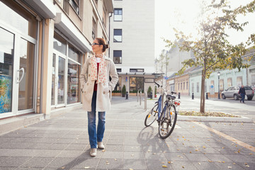 Woman walking down the street and looking at shop windows