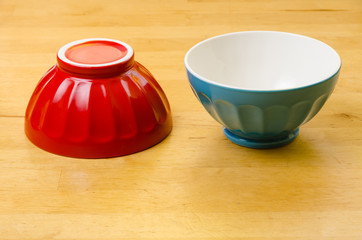two colorful bowls, one upside down