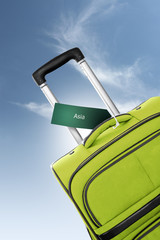 Asia. Green suitcase with label