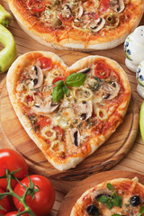 Heart shaped funghi pizza