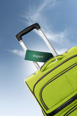 England. Green suitcase with label