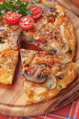 Spanish tortilla with mushrooms and vegetables
