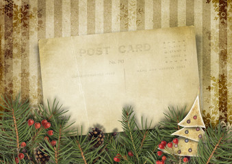 Vintage Christmas background with old postcard and firtree
