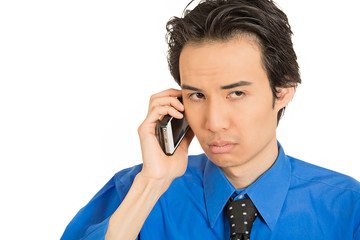 headshot upset depressed worried young man talking mobile phone