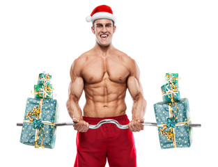 Muscular Santa Claus doing exercises with gifts over white backg