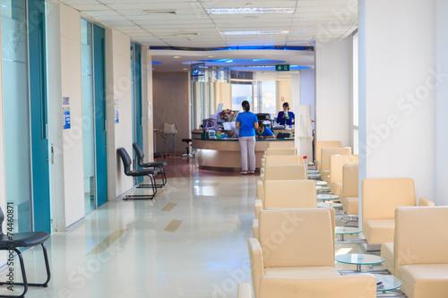 hospital indoor hallway and waiting seats - 74460871