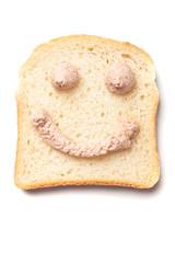 Pâté spread smiley on slice of bread
