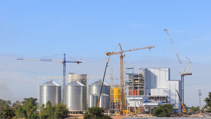 Industrial factory of animal feed storage with blue sky backgrou