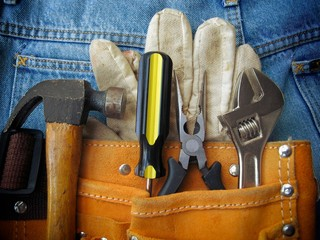Work Tools in Orange Tool Bag With Jeans