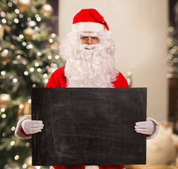 Santa Claus showing a blackboard