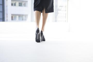 Young women wearing high heels