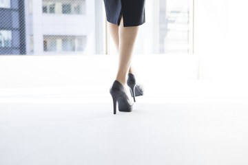 Women wearing black high heels