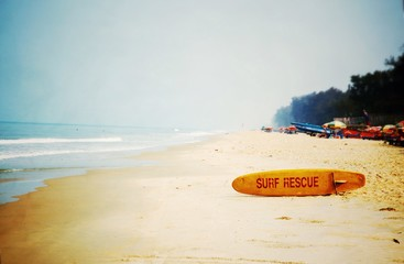 surfboard rescue on the empty beach
