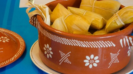 Peruvian cuisine: tamales in clay pot
