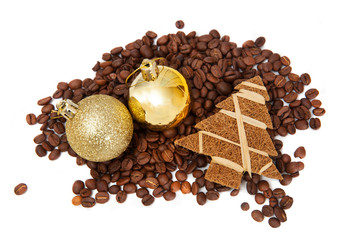 Coffee beans with smalldecorations on white background