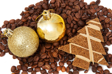 Coffee beans with small xmas tree and golden balls