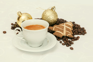 Small cup of espresso with christmas decorations