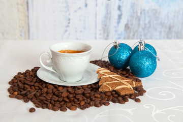 white cup of hot coffee with three blue christmas ball