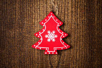 Red Christmas tree ornament on wooden background