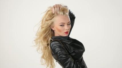 Fashionable beautiful blonde woman posing in studio in black