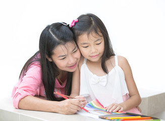 Mon and girl drawing a home work