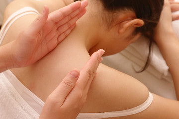 Close up of relaxing asian woman having massage on her neck and