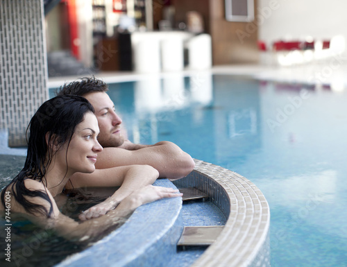 Papiers peints Detente Couple relaxing in jacuzzi of spa center