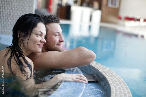 Papiers peints Detente Couple relaxing in jacuzzi of spa center