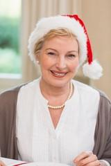 Portrait of a pretty mature woman in santa hat