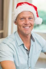 Portrait of handsome man in santa hat