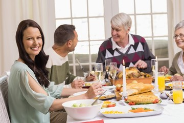 Smiling woman with her family during christmas dinner