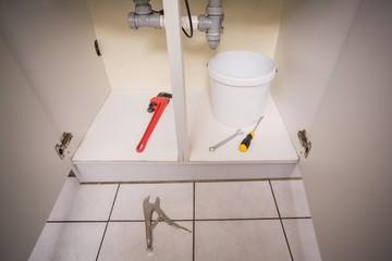 Plumbing tools under the sink