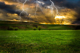 Fototapety Thunderstorm with lightning in green meadow.