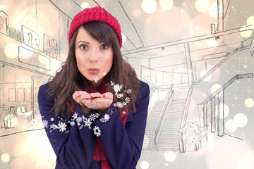 Composite image of festive brunette blowing over hands