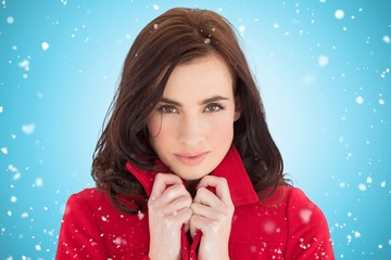 Composite image of portrait of a pretty brunette in red coat