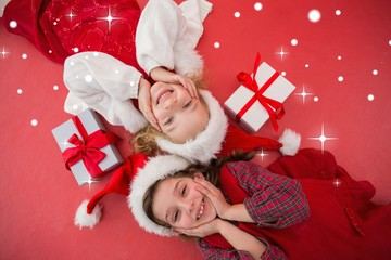 Festive little girls smiling at camera with gifts