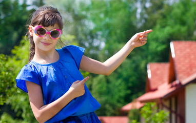 Girl pointing at new cottages