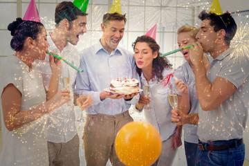 Casual businessmen team celebrating a birthday