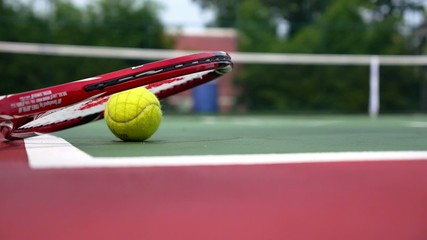 Tennis Racket with Balls on Court. Slow Motion.