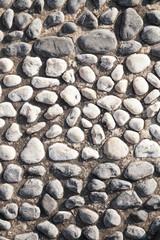 Closeup of black and white big pebble rocks